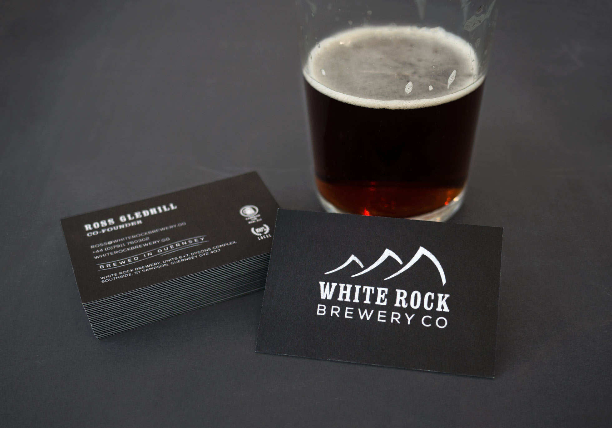 Business cards and a pint